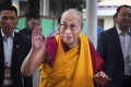 Tibetan spiritual leader the Dalai Lama greets devotees as he arrives at a temple for a religious talk in Dharamsala, India last week. Photo: AP
