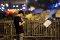 A pro-democracy demonstrator checks his phone in Hong Kong. WeChat is reportedly blocking messages about the protests. Photo: AFP