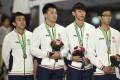 Hong Kong (L-R) bronze medallists Tsui Chi-ho,  Ng Ka-fung, So Chun-hong and Tang Yik-chun  pose with their medals. Photo: AFP