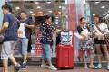 Travelers shop in a Causeway Bay road. Photo: May Tse