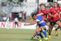 U20s skipper Hugo Stiles offloads under pressure against Taiwan during Hong Kong's opening Asian qualifying clash in Colombo. Photo: Dennis Muthuthantri for HKRFU
