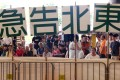 People protest against a funding application for the new-town developments in May. Photo: David Wong
