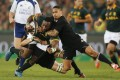 All Black Aaron Smith tackles South Africa's Tendai Mtawarira during their Rugby Championship match at Ellis Park in Johannesburg. Photo: Reuters