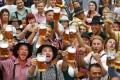 Oktoberfest revellers in Bavarian attire raise their one-litre mugs during the annual beer festival, which attracted millions of visitors from around the world. Photo: Reuters
