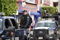 Mexican Federal policemen patrol in downtown Iguala. Photo: AFP