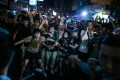 Demonstrators stand their ground in front of police officers in the occupied areas in Mong Kok. Photo: Bloomberg