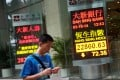 The Hang Seng Index dropped 336 points, or 1.4 per cent, to 23,198 at the market opening amid a broad slide in Asian markets. Photo: AP