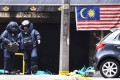 Bomb squad officers at the scene of the grenade attack outside the Sun Complex in the Bukit Bintang district of Kuala Lumpur. Photo: AFP