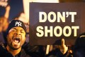 Protesters cheer after blocking an intersection after the vigil in St Louis on Thursday. Photo: AFP