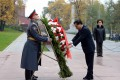 Premier Li Keqiang lays a wreath yesterday at Moscow's Tomb of the Unknown Soldier as part of his trip to Russia. Photo: Xinhua