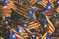 Catalans hold independence flags during celebrations of Catalonia National Day in central Barcelona on September 11. Photo: AFP