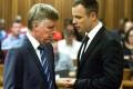 Oscar Pistorius (right) speaks with his lawyer. Photo: EPA