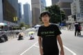 I've got four of these T-shirts, Alex Chow insists. Photo: AP