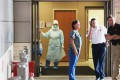 Health care workers wait for the arrival of a possible Ebola patient at the Texas Health Presbyterian Hospital in Dallas, Texas. Photo: AFP
