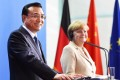 "Chinese Premier Li Keqiang and German Chancellor Angela Merkel attend a press conference  in Berlin. Germany has described the arrest last Friday of a Chinese woman working for a German newspaper on the mainland as ""worrying"". Photo: Xinhua"