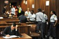 Oscar Pistorius takes notes on the third day of his sentencing during his ongoing murder trial in Pretoria. Photo: AFP