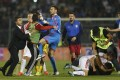 Fans and players of Serbia and Albania scuffle on the pitch. Photo: Reuters