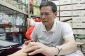 Wong Hok-yee, a Chinese medicine practitioner for 30 years, said the Watsons outlet near his tiny clinic has had no impact on his patients. Photo: May Tse