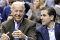 US Vice-President Joe Biden and son Hunter (right) appear at the Duke Georgetown NCAA college basketball game in Washington in 2010. Photo: AP
