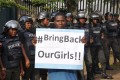 A protester urges the government to rescue the girls. Photo: AP