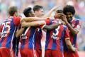 Bayern Munich players congratulate Xabi Alonso after his goal made it 2-0 against Werder Bremen. Photo: EPA