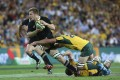 New Zealand's Sam Cane is tackled by Matt Hodgson of Australia during their Bledisloe Cup clash in Brisbane on Saturday. Photos: AP