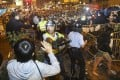 Police confront pro-democracy protesters trying to reoccupy Nathan Road in Mong Kok early this morning. Photo: Sam Tsang