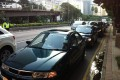 Cars queue during the drive-by protest. Photo: Raquel Carvalho