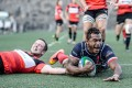 Lex Kaleca gets over the line to score one of Hong Kong Scottish's four tries against Valley on Saturday. Photos: HKRFU