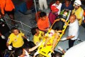 Rescue workers move an injured tourist on a stretcher to hospital. Photo: AP