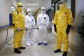 Health workers wear protection suits during an Ebola drill at a hospital in Guangzhou. Photo: Reuters