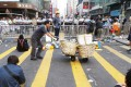 "A man pushes a handcart at a protest site in Mong Kok. Police have accused protesters of using children as ""human shields"". Photo: K.Y. Cheng"