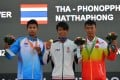 Gold medallist Cheng Kwok Fai (centre) of Hong Kong,  with silver medallist Phonoppharat Natthaphong (left) of Thailand and bronze winner Shi Chuankun of China at the award ceremony of the mistral men's windsurfing event. Photo: Xinhua