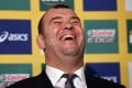 A beaming Michael Cheika after his appointment as Wallabies coach. Photos: AFP