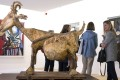 The Picasso Museum reopens in Paris. Visitors walk behind the sculpture 'The Goat' at the Picasso Museum in Paris. Photo: EPA