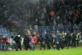 Riot police come on to the pitch during the  match between Slovan Bratislava and Sparta Prague at the Pasienky Stadium in Bratislava. Photo: AP