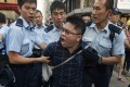 Police officers in Mong Kok lead away an anti-Occupy protester. Photo: EPA