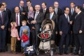 European Council President Herman van Rompuy holds his grandson as he poses with heads of state at the EU talks in Brussels. Photo: AP