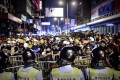Riot police and protesters face off in Mong Kok on October 19. Photo: AFP