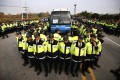 Police in Paju surround a bus transporting activists planning to launch balloons.Photo: Reuters