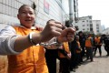 Gangsters arrested on economic crimes are paraded by Chinese police. Photo: AFP