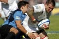 Victor Gresev of Russia fends off a tackle by Uruguay's Agustín Ormaechea during their RWC play-off in Montevideo. The South Americans won the match to qualify for London 2015 while Russia, who will play two tests against Hong Kong next month, are hungry to get back to their winning ways. Photo: EPA
