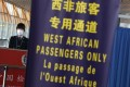 A quarantine official stands at a lane reserved for nationals from West African countries hit by the Ebola virus, at Beijing Capital International Airport. Photo: Reuters
