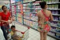 Customers select baby milk formula at a supermarket in Haikou in the southern province of Hainan in August 2013. Photo: AFP