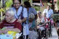 Guests and their caregivers at the Baan Kamlangchay care home, in Faham, near Chiang Mai.