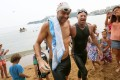 Discovery Bay residents Olivier Baillet and Bruce Pye emerge exhausted but also exhilarated after Seas, a charity that aims to improve the state of the city's waters. Photo: Joanthan Wong