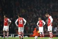 Arsenal can't believe it after throwing away the lead. Photo: AFP
