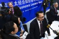 Eduardo Pedrosa (centre), Pecc secretary general, speaks to the press after launching the report in Beijing. Photo: Xinhua