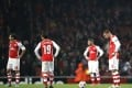 Arsenal fans fell silent after the Gunners were held to a 3-3 draw by Anderlecht in the Champions League. Photos: AFP