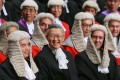 Under the Basic Law, judges are appointed by the chief executive on the recommendation of a commission, whose members are chosen by the government.